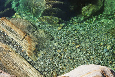 Stones and rocks in clear turquoise waters of Verzasca river, Verzasca Valley, Ticino, Switzerland - GWF06464
