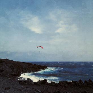 Spain, Province of Santa Cruz de Tenerife, Los Llanos de Aridane, Paraglider flying over coast ofLa Palmaisland - DWIF01075