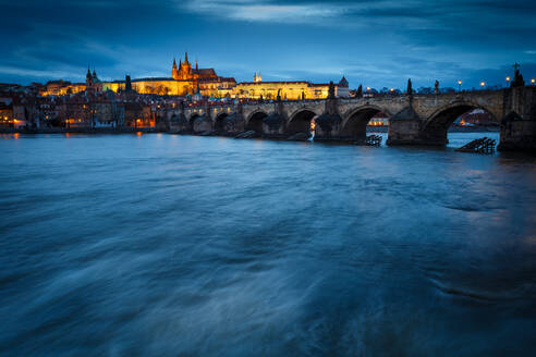 Evening view of Charles Bridge and Prague Castle over river Vltava. - CAVF75415