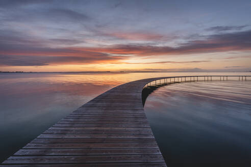 Denmark, Aarhus, Long exposure of Infinite Bridge and Aarhus Bay at sunrise - KEBF01474