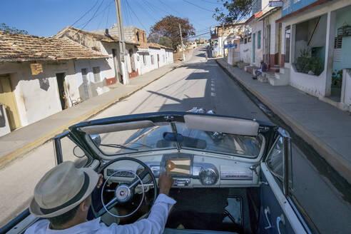 Taxi driver driving a vintage convertible car, Trinidad, Cuba - PAF01947