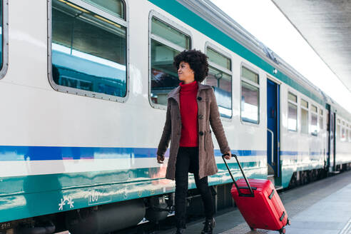 Tourist woman going for vacation trip on train - CAVF75681