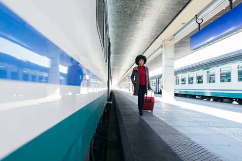 Tourist woman going for vacation trip on train - CAVF75696