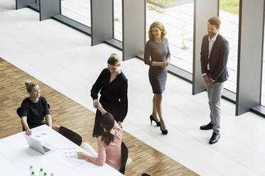 Business people shaking hands in modern office conference room - BMOF00288
