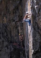 Rock climbers, Mother Carey's Kitchen, Pembrokeshire, United Kingdom - ALRF01740