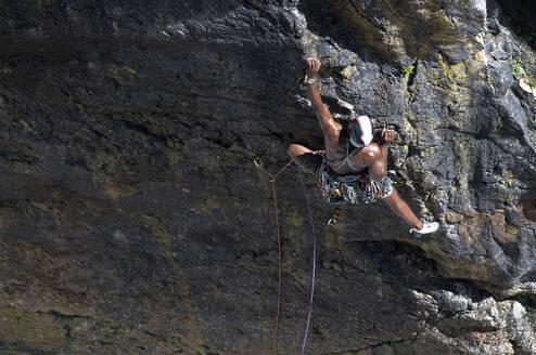 Rock climber, Mother Carey's Kitchen, Pembrokeshire, United Kingdom - ALRF01743