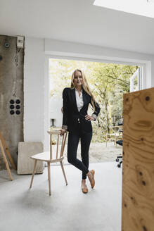 Portrait of a confident blond young businesswoman - GUSF03382