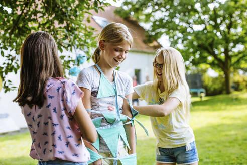 Happy girls having fun on a birthday party outdoors - SODF00622