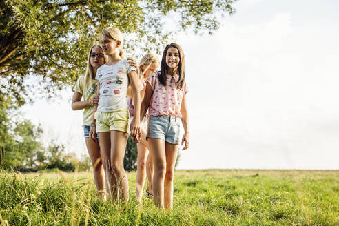 Girls standing on a field in the countryside - SODF00640