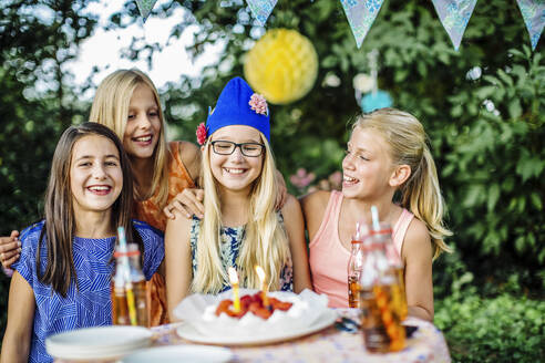 Portrait of happy girls on a birthday party outdoors - SODF00661