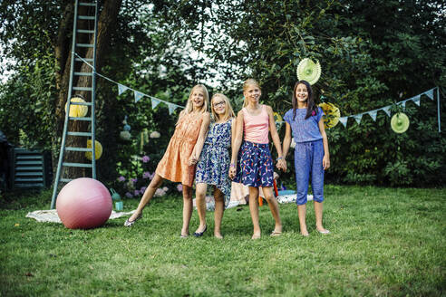 Portrait of happy girls on a birthday party outdoors - SODF00685