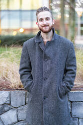 Portrait of smiling young man in the city - FBAF01305