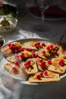 Spain,Tray of crispbreads with raw salmon and red currant berries - AFVF05463