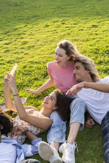 Happy friends taking a selfie on a meadow - AFVF05474