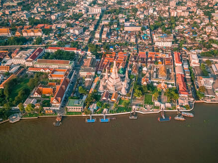 Aerial view of the Chao Phraya River with The 4 Kings' Phra Maha Chedi in the background, Phra Nakhon, Bangkok, Thailand - AAEF06700