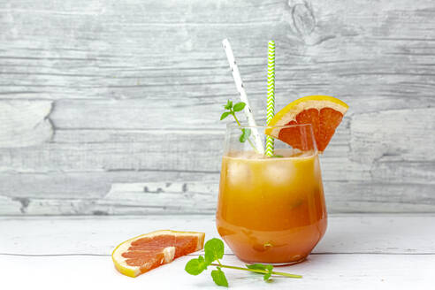 Glass of non-alcoholic grapefruit cocktail - SARF04477