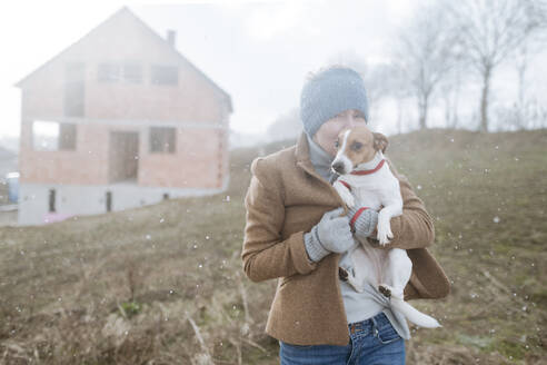 Portrait of mature woman with her dog on winter's day - VYF00022