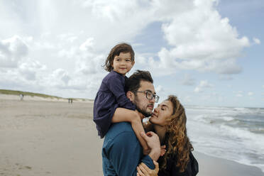 Parents spending with her little daughter on the beach, Scheveningen, Netherlands - OGF00171