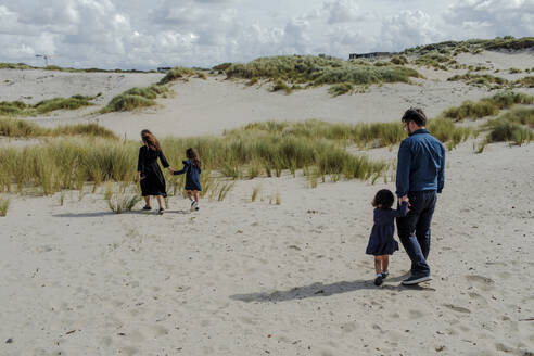 Family with two little children walking in the dunes, The Hague, Netherlands - OGF00187