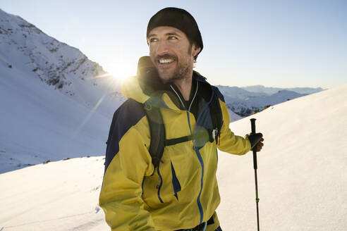 Portrait of man during ski tour, Lenzerheide, Grisons, Switzerland - HBIF00073