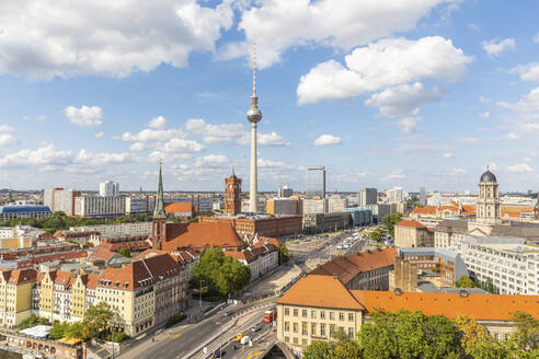 Germany, Berlin, Clouds over Fernsehturm Berlin tower and surrounding buildings - WPEF02706