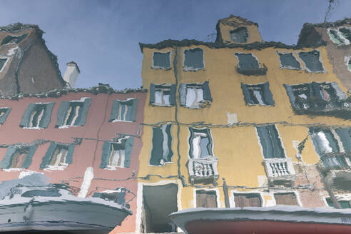 Italy, Venice, Houses reflecting in canal - MRAF00492