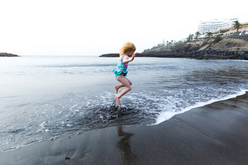Boy playing at the seafront, Adeje, Tenerife, Canarian Islands, Spain - IHF00278