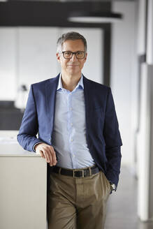 Portrait of confident businessman in office - RBF07160