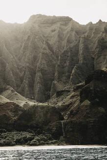 Scenic view of seascape and mountains at Nā Pali Coast State Wilderness Park, Kauai, Hawaii, USA - LHPF01176