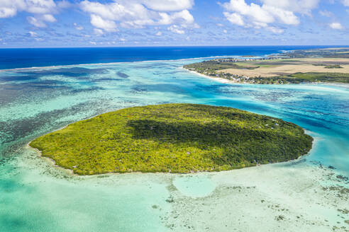 Lush vegetation on Ile aux Aigrettes atoll in the turquoise lagoon, aerial view by drone, Pointe d'Esny, Mahebourg, Mauritius, Indian Ocean, Africa - RHPLF14465