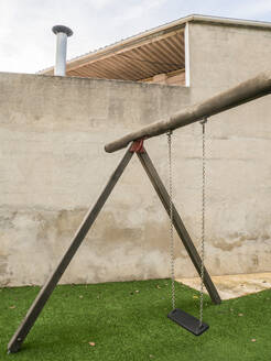 Spain, Simple swing standing on artificial grass - JMF00482