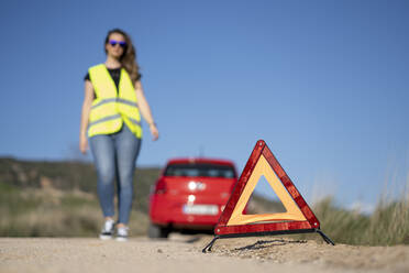 Warning triangle at a breakdown in the countryside - OCMF01079