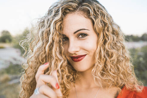 Portrait of blond young woman with red lips - DAMF00267