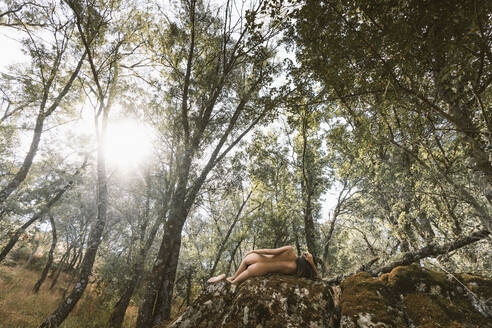 Female nude on rock in the forest - DAMF00273
