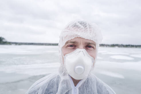 Portrait of man wearing protective suit and mask - EYAF00985
