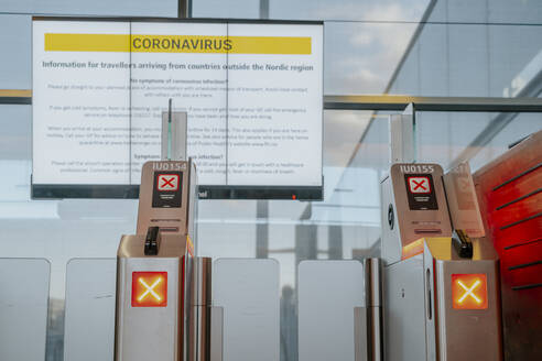 Information sign with safety regulations regarding coronavirus at Oslo airport, Norway - STDF00206