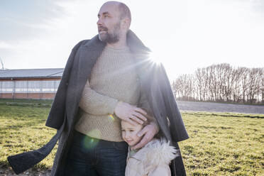 Father and little daughter on a field in winter - VYF00073