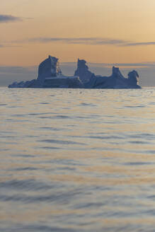 Majestic iceberg formations on sunset Atlantic Ocean Greenland - HOXF05728