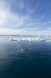 Polar ice melting on sunny blue Atlantic Ocean Greenland - HOXF05785