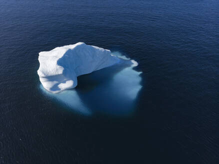 Drone point of view majestic iceberg on sunny blue Atlantic Ocean Greenland - HOXF05803