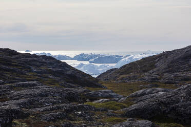 Rocky landscape overlooking icebergs Disko Bay West Greenland - HOXF05809