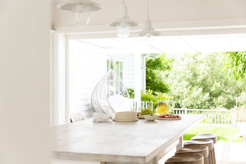 Home showcase kitchen open to summer patio - CAIF24710