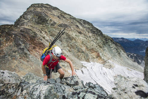 High angle view of backpacker climbing a rocky mountain. - CAVF77964