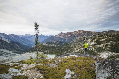 Hiker standing on viewpoint at sunrise - CAVF77982