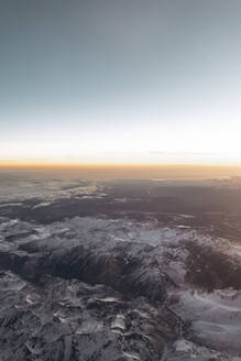 Finland, Aircraft view of snowcapped mountains at sunrise - AMAF00020