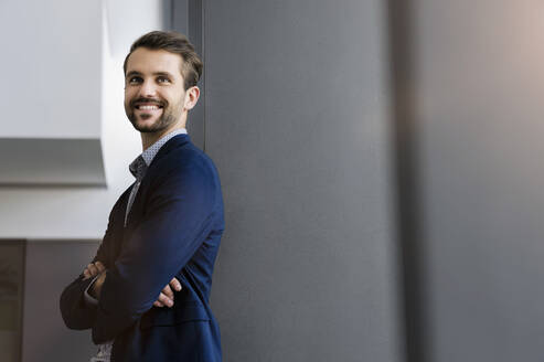 Portrait of happy young businessman looking at distance - BMOF00342