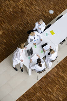 Female doctors having a meeting in conference room - BMOF00372