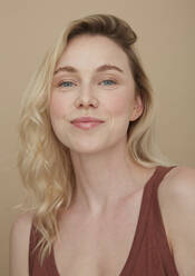 Portrait of smiling blond young woman - PGCF00070