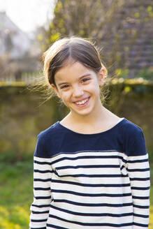 Portrait of smiling girl in garden - LVF08724