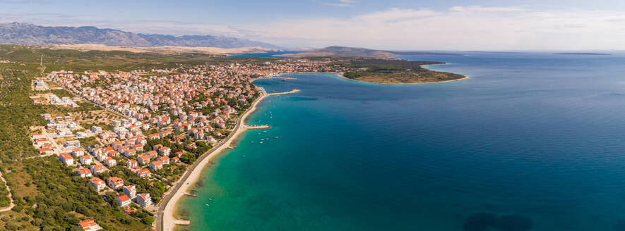 Panoramic aerial view of Novalja coastal line during the summer, island Pag, Croatia. - AAEF07679
